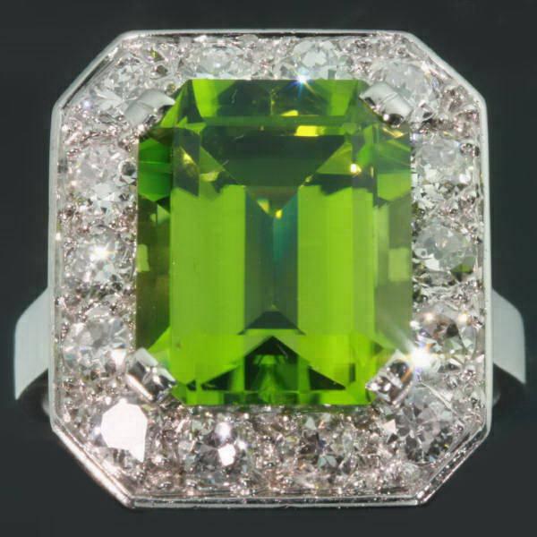 Magnificent platinum Art Deco engagement ring with big peridot and brilliants