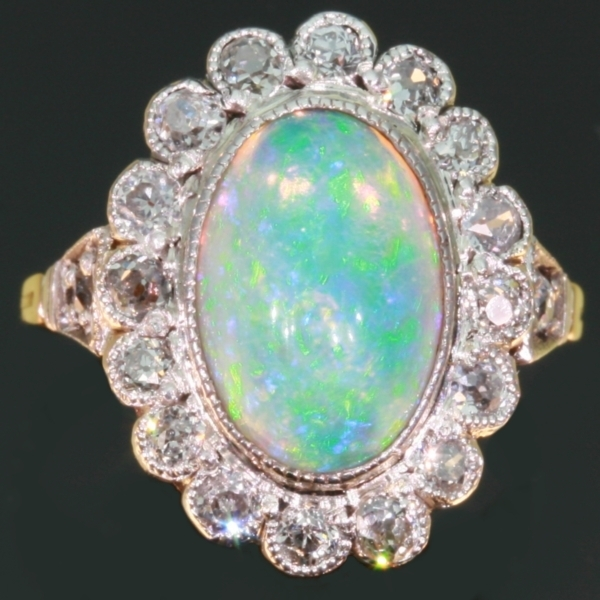 Vintage opal engagement ring diamonds setting