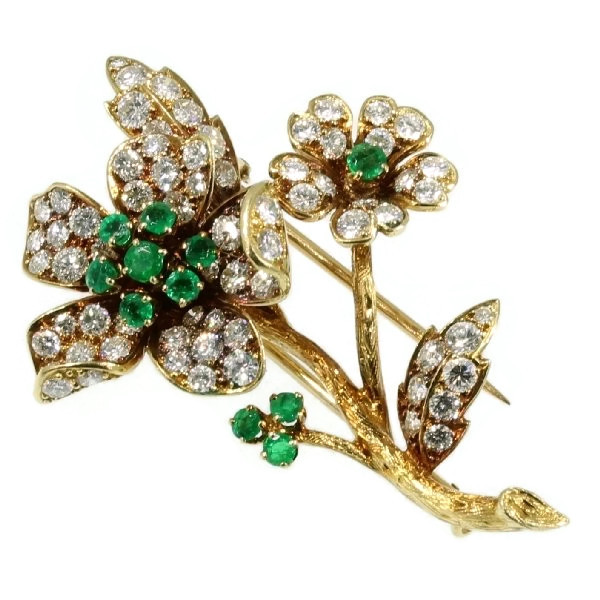 Fifties French gold flower brooch with brilliants and emeralds
