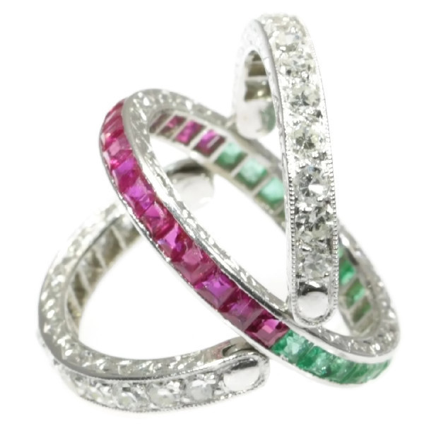 Magnificent eternity band with rubies and emeralds and hinged diamond parts