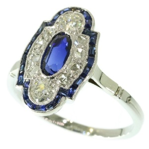 Elegant estate platinum Art Deco diamond and sapphire engagement ring
