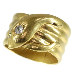 Antique gold English coiled snake ring with old brilliant cut diamond (ca. 1893)