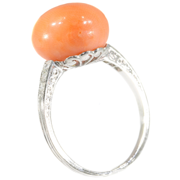 Typical platinum Art Deco diamond ring with coral
