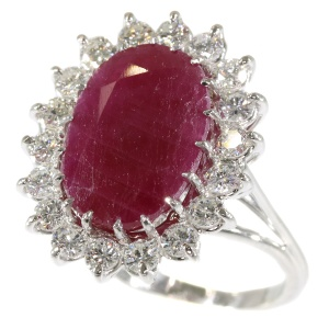 Stunning cocktail ring with one big natural untreated ruby 11.21crt and diamonds