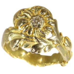Late Victorian early Art Nouveau flower ring with natural fancy color diamond
