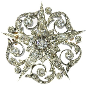 French Victorian antique star brooch filled with old mine brilliant cut diamonds