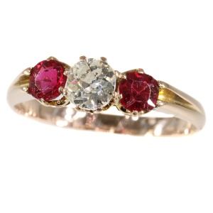 Antique ring with old mine brilliant cut diamond and two red strass stones