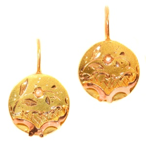 Antique gold earrings in two tones of 18K gold set with natural seed pearls