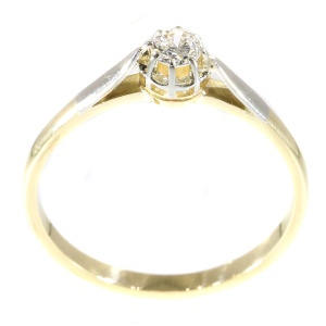 Fifties solitair diamond engagment ring