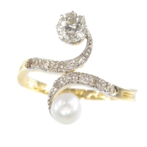 Elegant Belle Epoque diamond and pearl engagement ring so called toi et moi